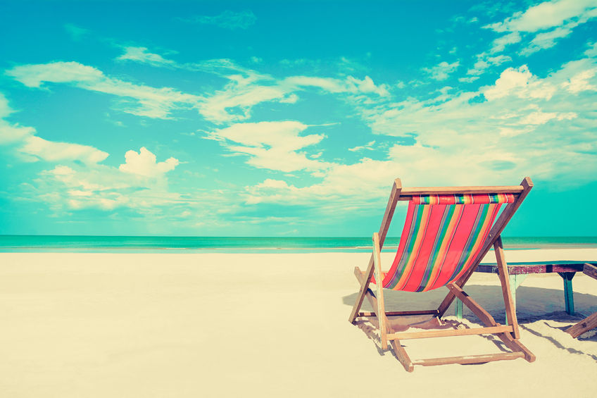 44141296 - beach chair on white sand beach in sunny sky background, vintage tone - summer holiday concept