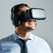 57365184 - businessman wearing virtual realty stimulator
