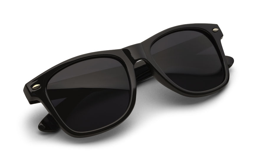 38286288 - folded black sunglasses isolated on white background with clipping path.