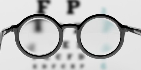 52324855 - pair of round-lens eyeglasses with eyesight test and blur