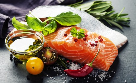 43903130 - delicious  portion of fresh salmon fillet  with aromatic herbs, spices and vegetables - healthy food, diet or cooking concept
